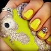 black pattern on yellow nail art