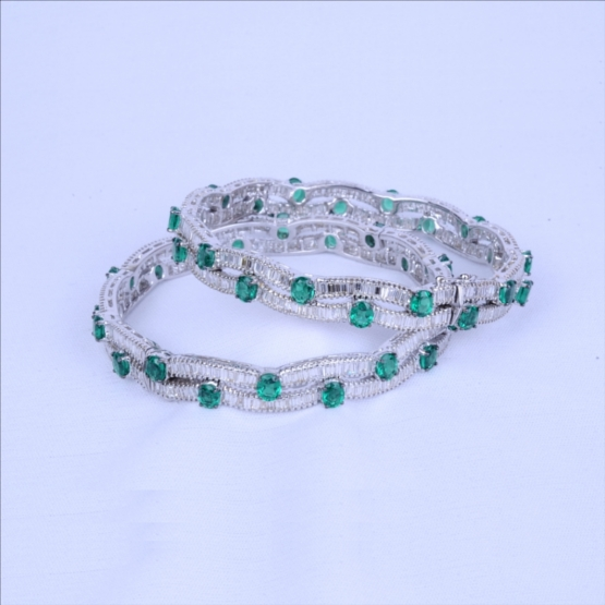 Colombian Emerald Bangles with Diamonds Baguettes Running Through Channel Setting
