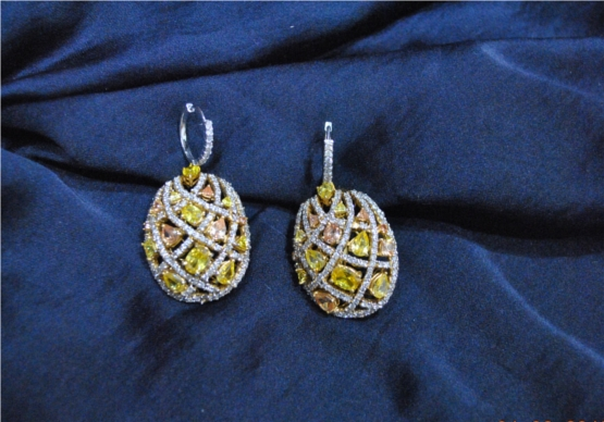Drop dead gorgeous diamond earrings with multi-hued yellow sapphires