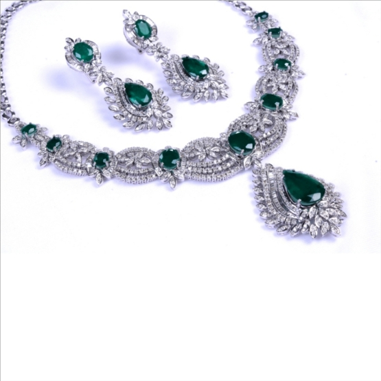 Round & Baguette Diamonds Necklace Set Complimented With Fine Colambian Emerald