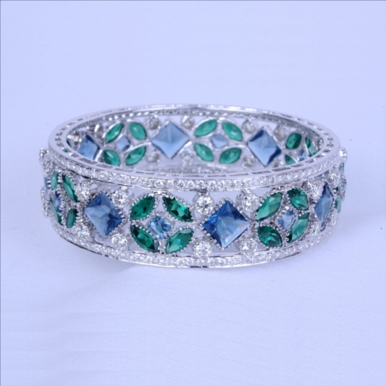 Emerald & Sapphire Kada in 14 k White Gold With 25 Pointer Diamond