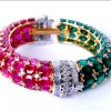Diamond Bracelet in Yellow Gold with Oval Shaped Emerald and Rubies
